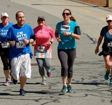 Runners approaching the finish line (L to R: Jen Dauley, Chris Condon, Erin Alcott, unknown, Susan Marshall