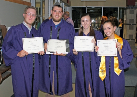 Construction Technology grad Daniel Brochu and Manufacturing & Engineering Technology grad Russell Poirier, both of Upton, joined Business Technology grad Sarah Trudeau of Northbridge and Cosmetology grad Emma Sexton of Upton in proudly displaying their student-achievement awards.